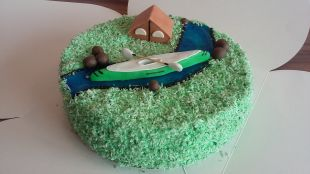 Baidarė ir palapinė ant torto